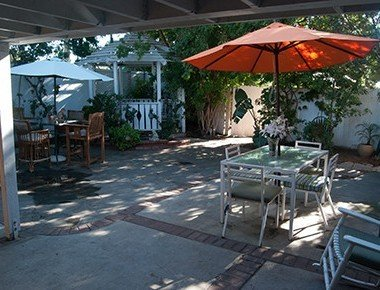 patio with tables covered by umbrellas