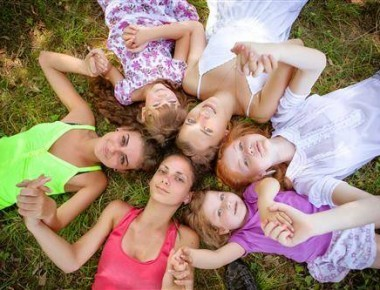 group of girls posing for pictures
