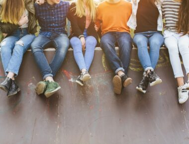 A group of teenagers hanging out outdoor.