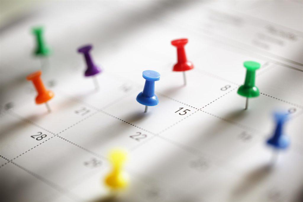 An inpatient rehab calendar full of push pins