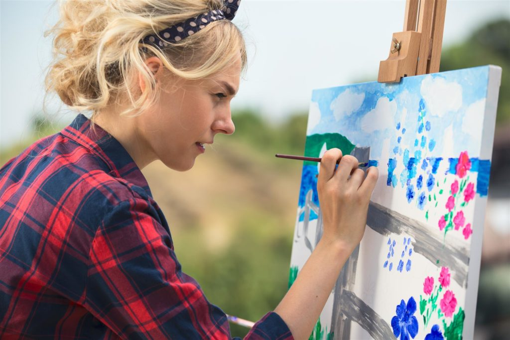 Beautiful Woman Artist Paints A Colorful Picture