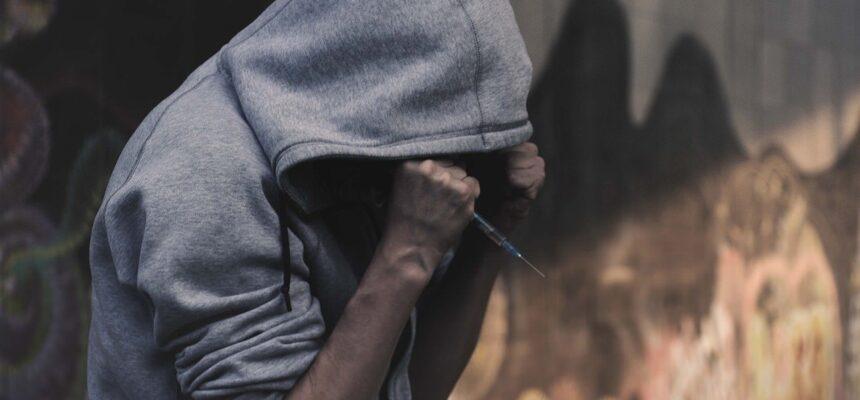 Depressed Abuse Addict Man With Syringe In Hand