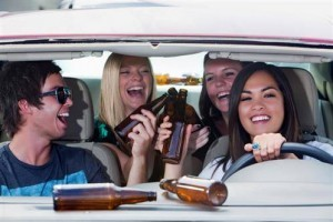 3 women and a man are partying in the car.
