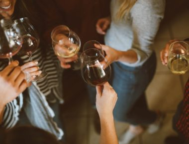 Girls Toasting With Wine At A Party
