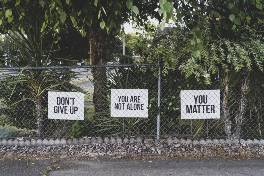 Inspiring Signs Outside On A Fence