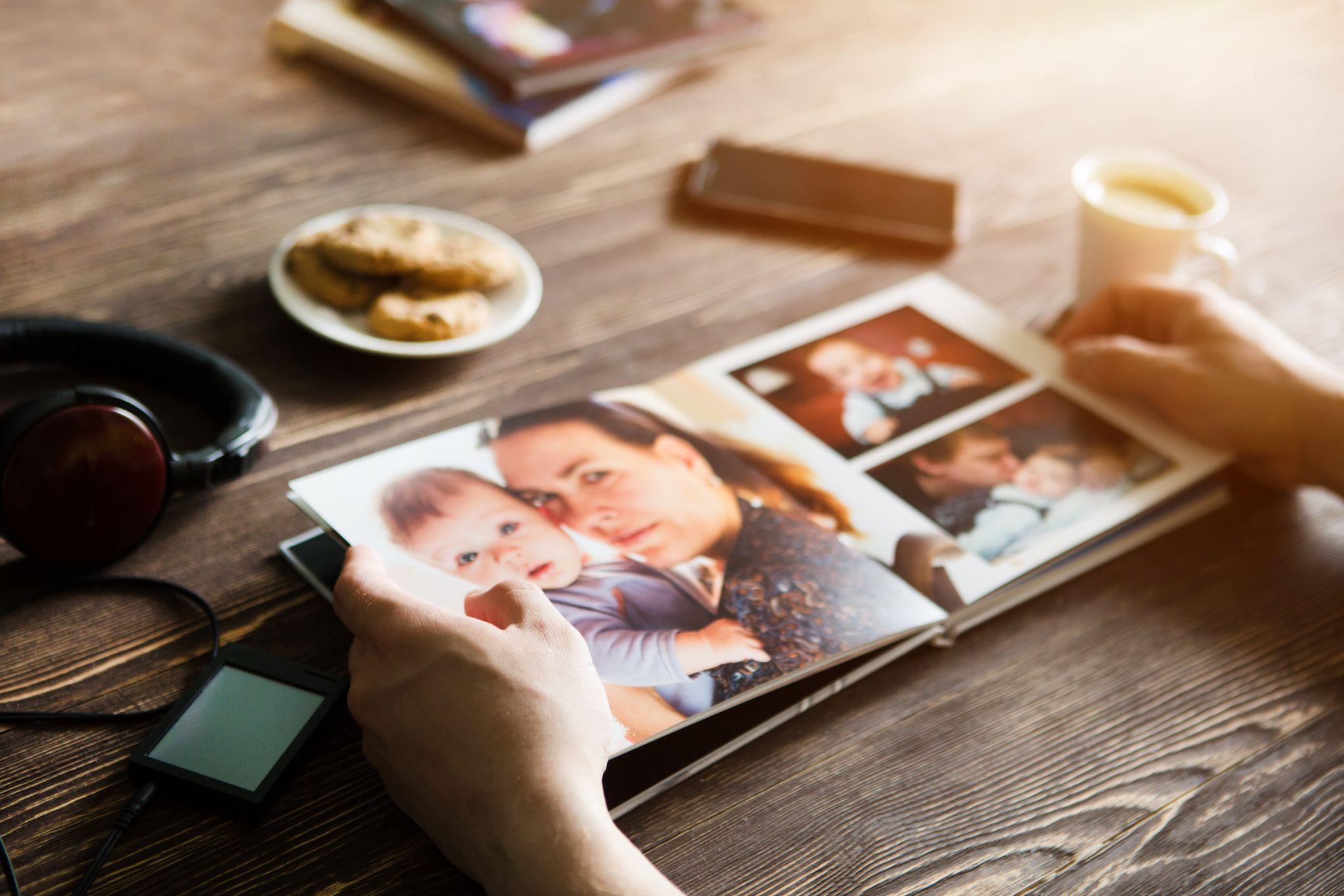 man holding a family photo album