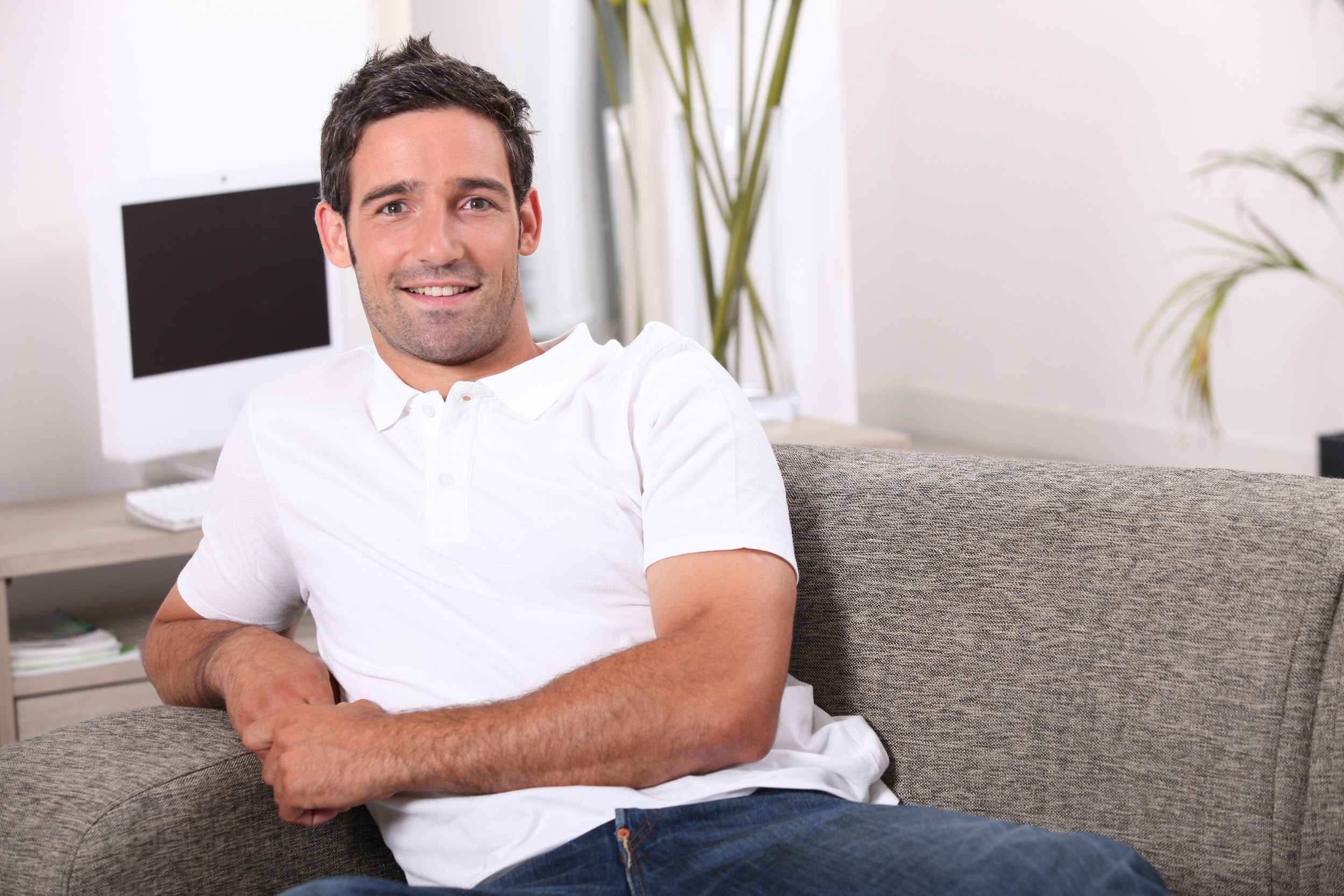 man sitting in a comfortable couch