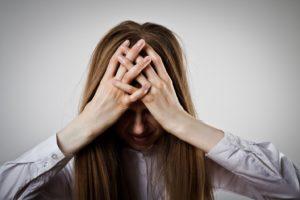 opioid addict holding forehead