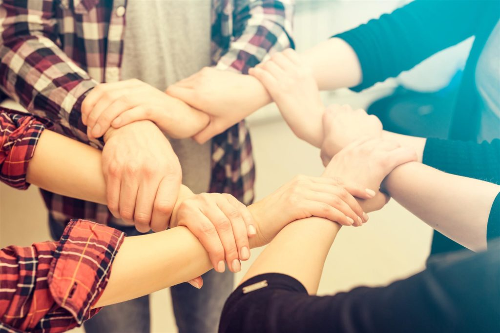 12-step group holding hands in circle