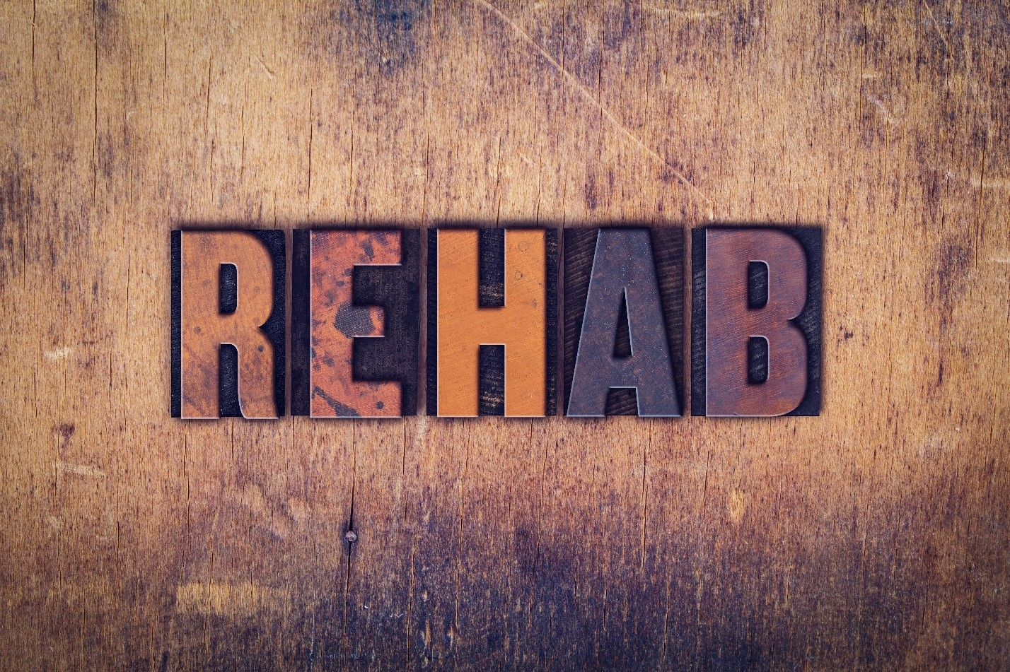 rehab sign on wood