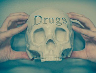 Drugs written on skull