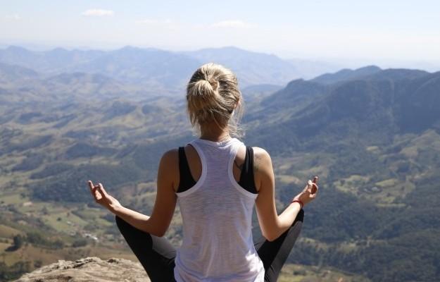 Woman Meditating On Mountain1