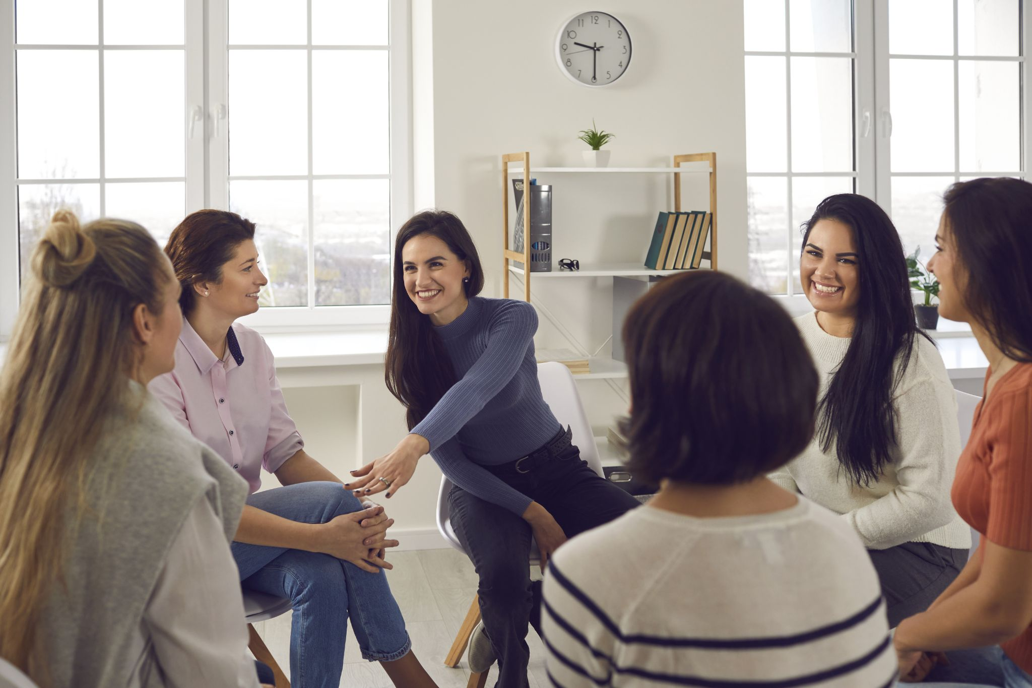 young women in group therapy session